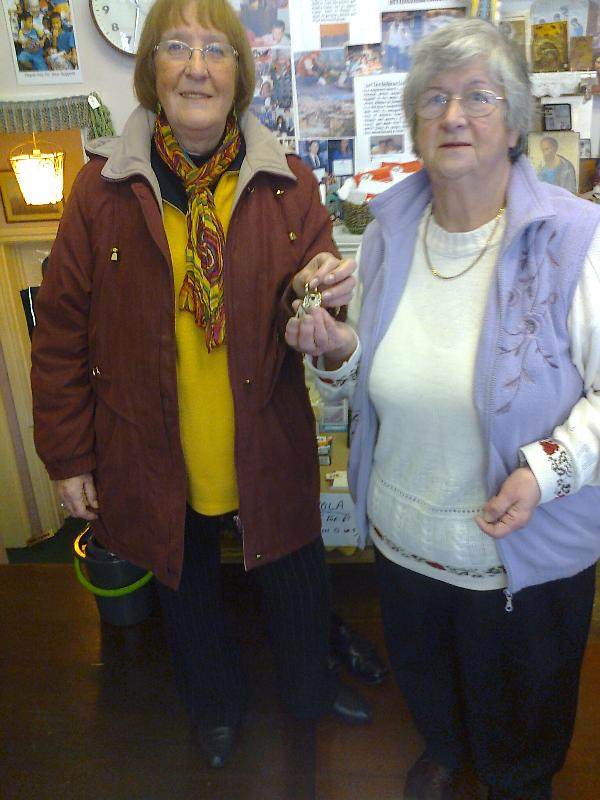 Susan Poole hands over the shop keys to Jackie Seals.